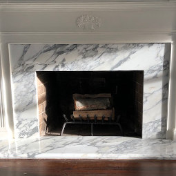 Calacatta cervaiole polished marble fireplace